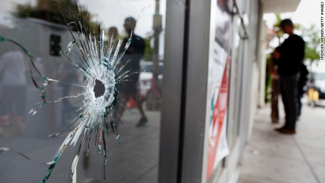 Caption:ISLA VISTA , CA - MAY 24: Bullet holes are seen in the window of the IV Deli Mart, one of several crime scenes on May 24, 2014 in Isla Vista, California. A mentally disturbed 22-year-old man sprayed bullets from his car in the Southern California college town of Isla Vista, killing seven people. (Photo by Spencer Weiner/Getty Images)