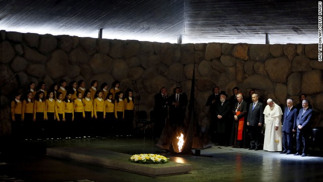Pope Francis stands alongside Israeli President Shimon Peres, left of Francis, and Israeli Prime Minister Benjamin Netanyahu, right of Francis, at the Hall of Remembrance in the Yad Vashem museum.