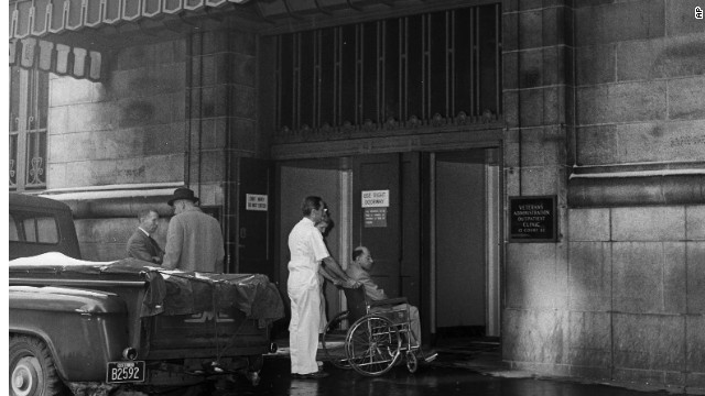 A VA patient wheeled into an outpatient clinic in Boston in 1961. The American Medical Association said vets should be treated in private hospitals