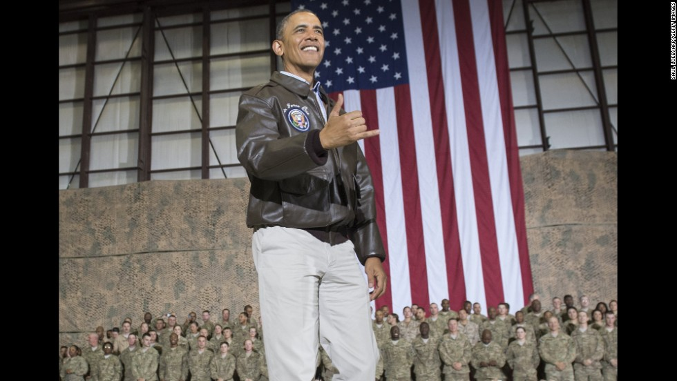 "Obama does a Hawaiian ""shaka"" as he greets U.S. troops during a surprise visit to Afghanistan on May 25, 2014."