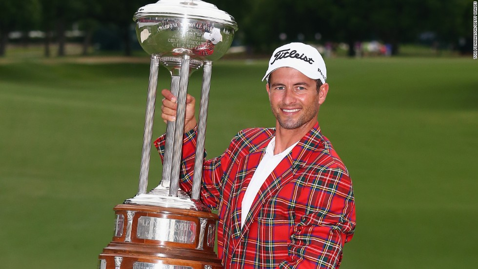 Adam Scott gets to grip with the massive Leonard Trophy after claiming the Colonial tournament in Texas.