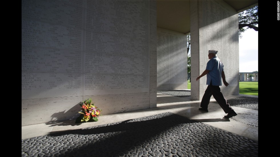 An American veteran passes by marble walls engraved with names of fallen U.S. soldiers at the Manila American Cemetery and Memorial in Taguig, Philippines, on May 25, 2014.