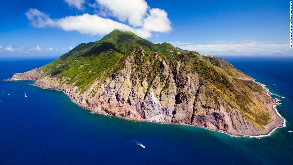 Like Saba (pictured), a few captivating islands in the remote fringes of the Caribbean, Pacific and Atlantic still belong to some of the world's more powerful nations. Here's a look at some of them.
