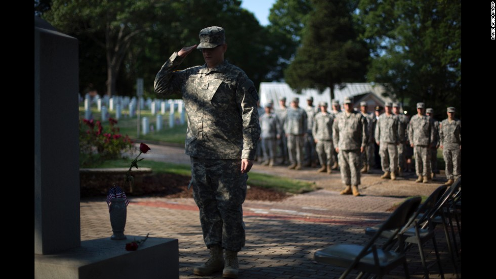 Pvt. John Schena of the Georgia State Defense Force salutes after placing a rose at a Pearl Harbor memorial May 26, 2014, at Marietta National Cemetery in Marietta, Georgia.