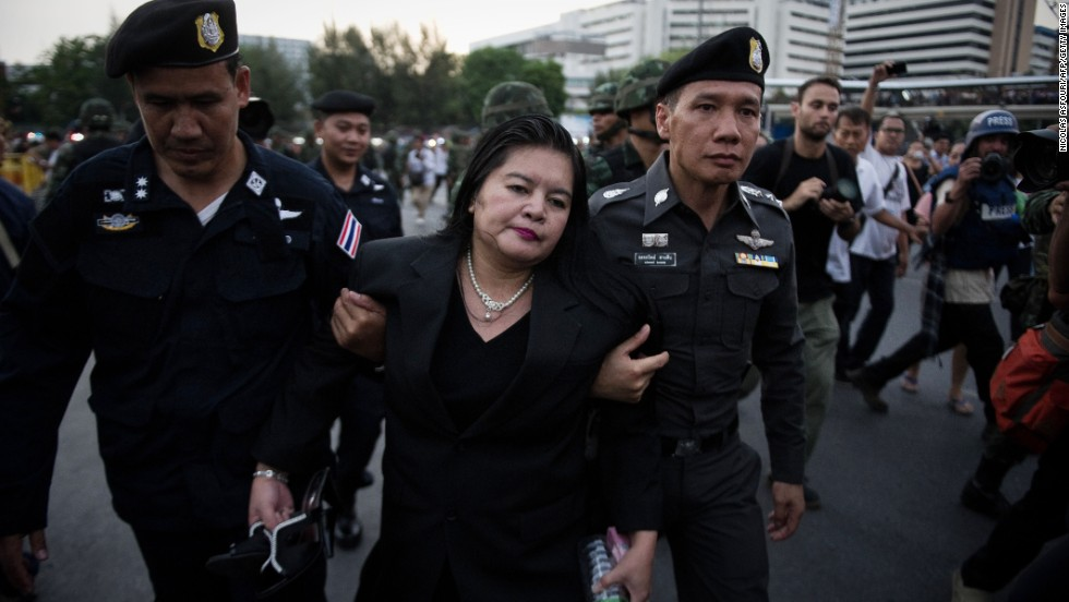 Thai police take a woman away from an anti-coup protest in Bangkok on May 26.