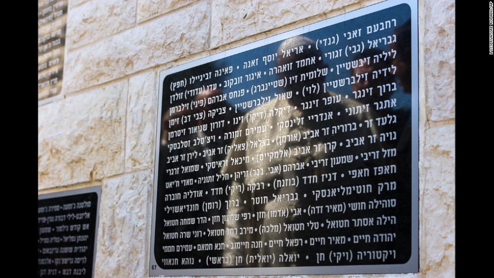 The Pope's reflection is seen May 26 on a marble plaque in Jerusalem that's engraved with names of Israeli civilians killed by terrorism.