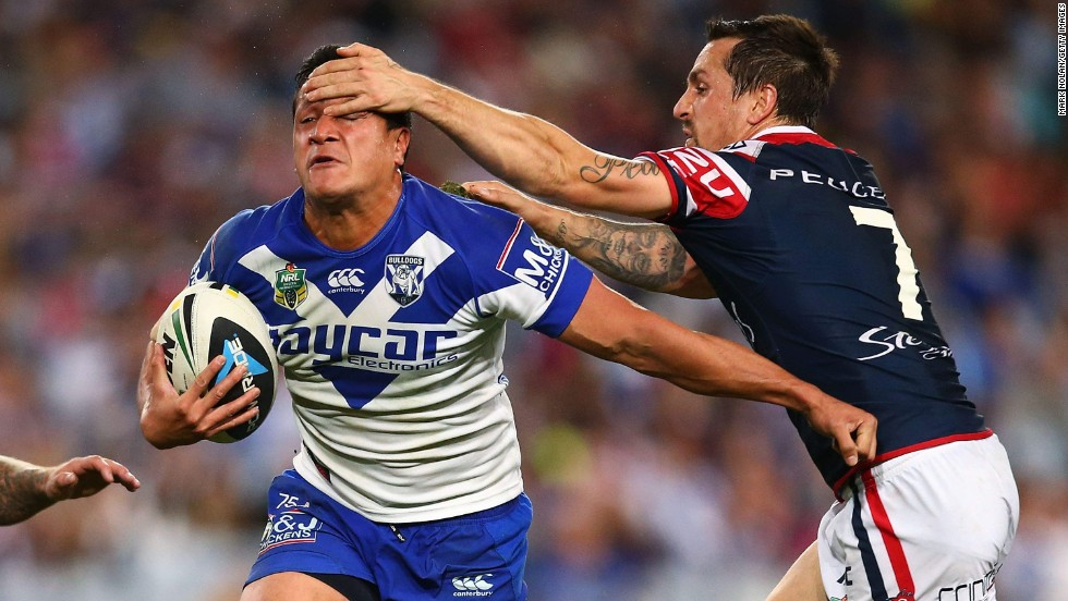 Mitchell Pearce of the Sydney Roosters tries to tackle Chase Stanley of the Canterbury-Bankstown Bulldogs during a National Rugby League match Friday, May 23, in Sydney. The Roosters won the game 32-12.