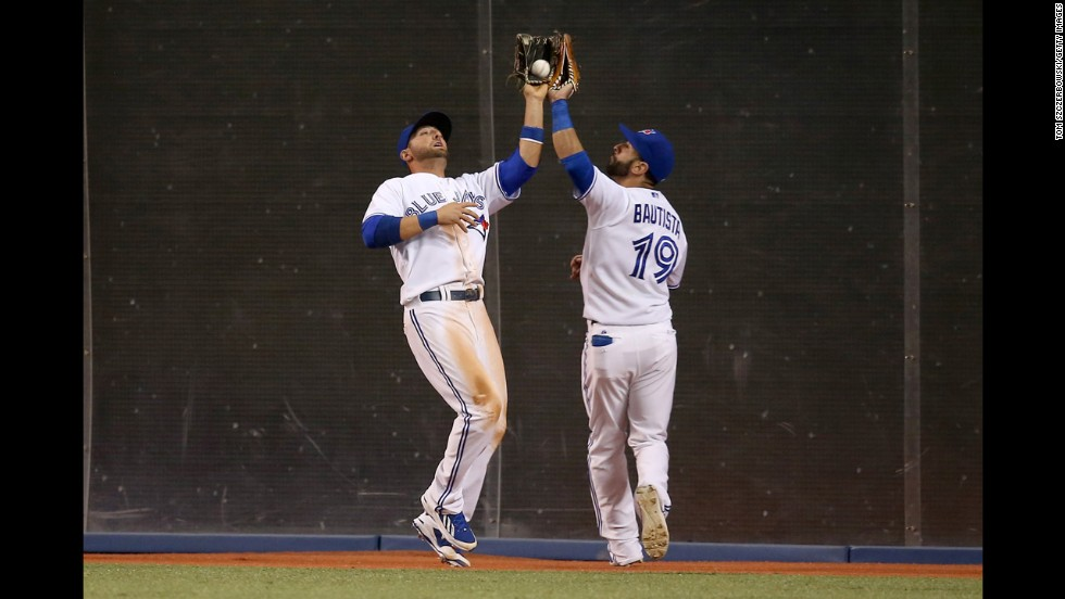 "Kevin Pillar of the Toronto Blue Jays nearly collides with teammate Jose Bautista as he catches a ball during a home game against the Oakland Athletics on Friday, May 23. <a href=""http://www.cnn.com/2014/05/20/worldsport/gallery/what-a-shot-0520/index.html"">See 36 amazing sports photos from last week</a>"