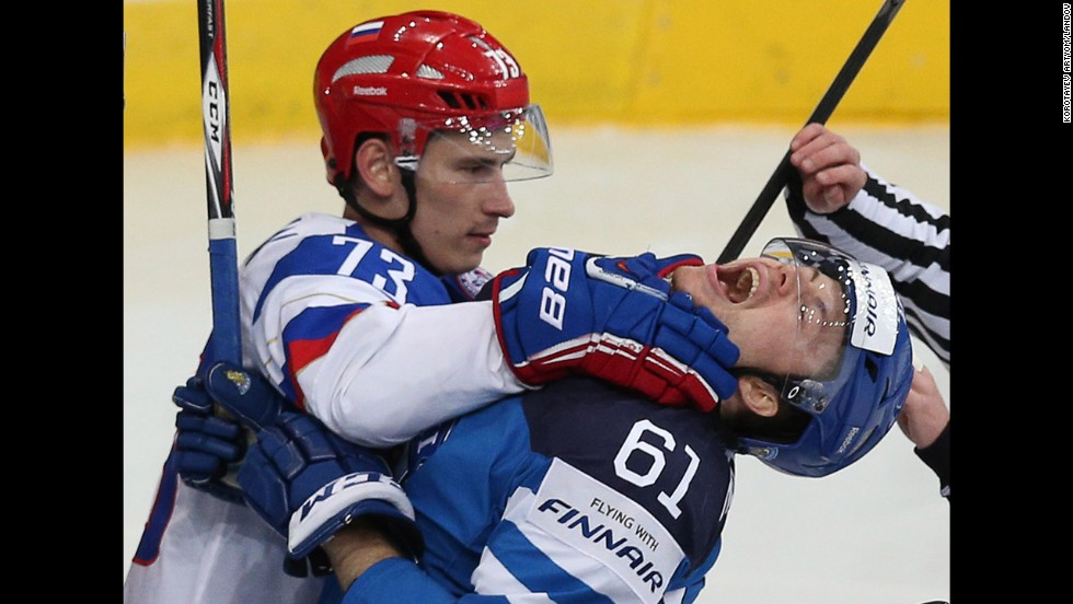 Russia's Maxim Chudinov, left, scuffles with Finland's Tommi Huhtala in the final of the Ice Hockey World Championship, which took place Sunday, May 25, in Minsk, Belarus. Russia won the game 5-2 for its fifth world championship since the breakup of the Soviet Union.