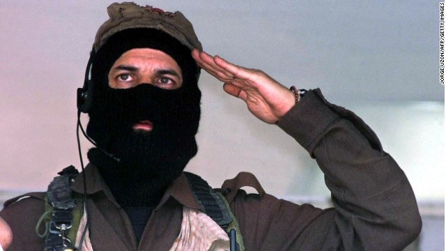 Subcommander Marcos, rebel leader of the Zapatista National Liberation Army (EZLN), sings the EZLN anthem at the closing of a rally in the Metropolitan Autonomous University of Azcapotzalco in Mexico City, Mexico, on March 20, 2001. Subcomandante Marcos, the mysterious masked leader of Mexico's Zapatista rebels, said on May 25, 2014, that he was stepping aside as chief of the 20-year-old movement.