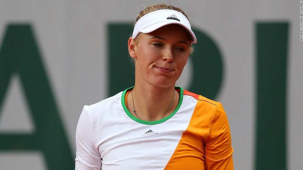Denmark's No. 13 seed Caroline Wozniacki lost to Belgium's Yanina Wickmayer on her first outing since news broke that her engagement to golfer Rory McIlroy was off.