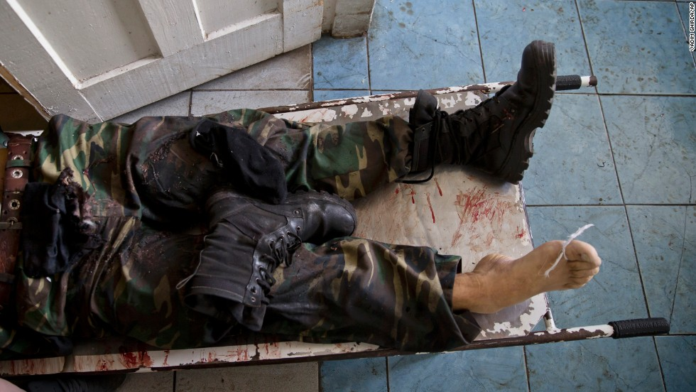 The body of a pro-Russian militant lies on a stretcher at a morgue in Donetsk on May 27. He was killed in clashes around Donetsk's airport, which was seized by pro-Russian separatists a day earlier. Ukrainian forces moved in and reclaimed the facility.