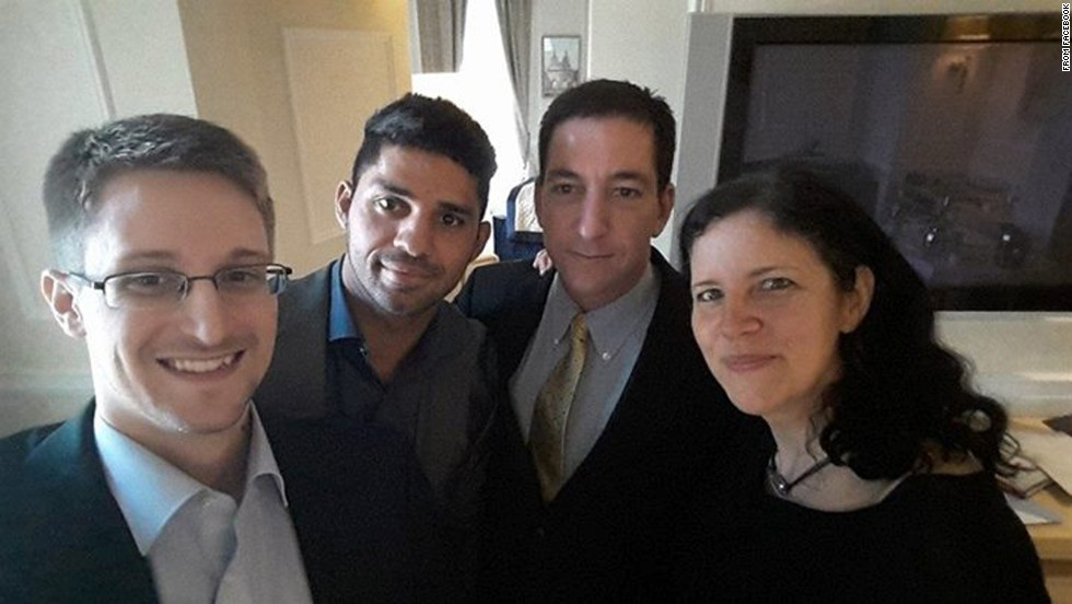 "National Security Agency whistleblower Edward Snowden, left, poses for a photo with, from right, journalist Laura Poitras, journalist Glenn Greenwald and Greenwald's husband, David Michael Miranda. Miranda <a href=""http://on.fb.me/1ojSRGh"" target=""_blank"">posted the selfie</a> to his Facebook page on Thursday, May 22. Greenwald was the journalist who broke the Snowden story last year."