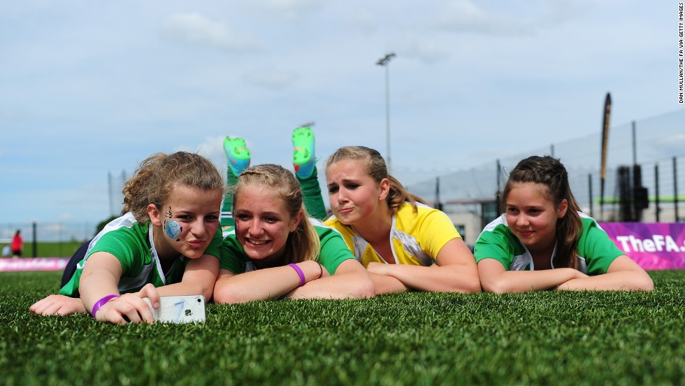 Young soccer players pose for a selfie during the FA Girls' Football Festival in Hereford, England, on Wednesday, May 21.