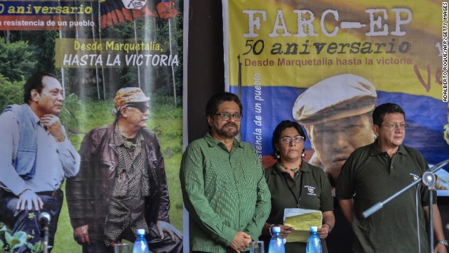 "The head of the Revolutionary Armed Forces of Colombia (FARC) delegation holding peace talks with the Colombian government, commander Ivan Marquez (L), is pictured during a press conference in Havana on May 27, 2014, on the 50th anniversary of the rebel group's foundation. The head of the FARC, Timoleon Jimenez, alias ""Timochenko, "" marked the anniversary expressing hope for an ""effective peace"" while denouncing the government of President Juan Manuel Santos. In a 30-minute video posted on the Internet ""Timochenko"" warned that the FARC ""will do what's necessary if the oligarchy persists in blocking peace."""