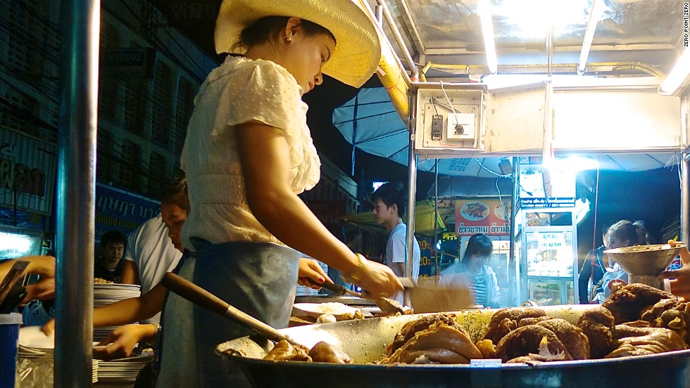 "In a small roadside night market in Chiang Mai, a lady in a cowboy hat is renowned for her version of khao kha muu -- a tender, stewed pork shank. ""At first the light was shining in my eyes, so I wore a hat. People recognized my stall with that hat, so it became my signature,"" she says."