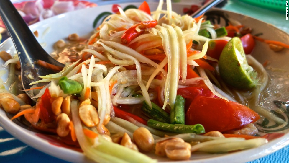 A trip to Thailand isn't complete without a variation of papaya salad. This version -- som tam Thai -- is a balancing act of shredded green papaya with sweet (palm sugar), sour (lime), spicy (Thai chiles) and salty (chopped peanuts and dried shrimp) flavors.