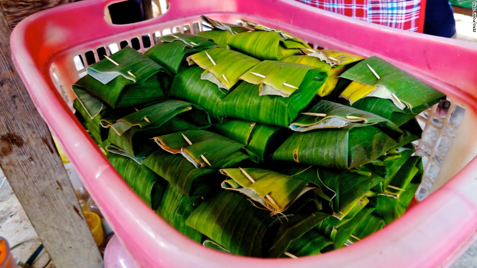 "The pork brains are then wrapped in a banana leaf and grilled. ""It's like eating scrambled eggs,"" Ricker says. Banana leaves are often used in Thai cuisine to maintain moisture in proteins during cooking."