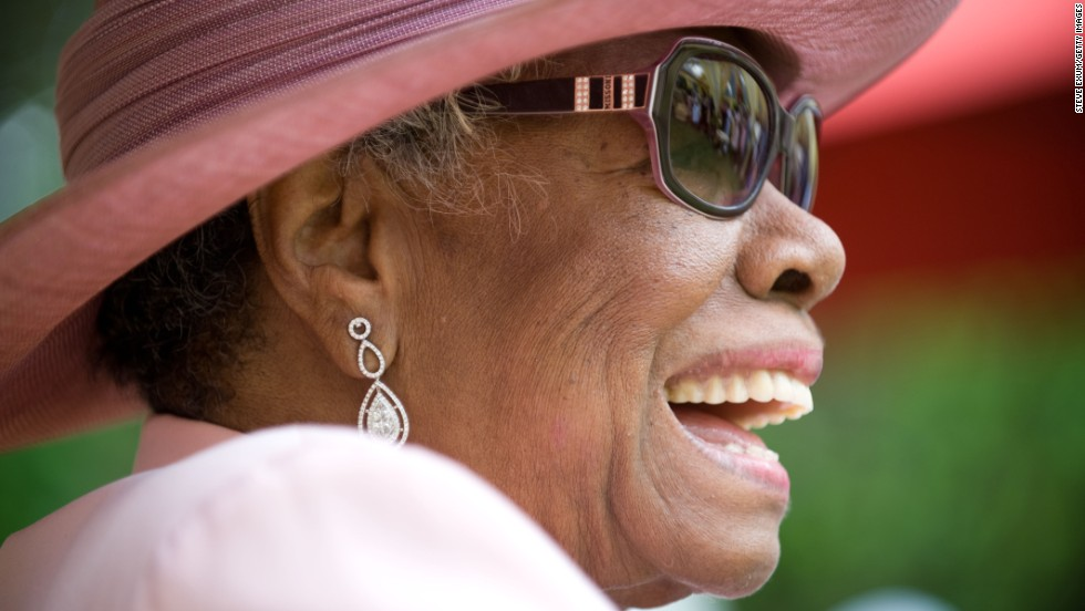 Angelou laughs during her 82nd birthday party at her home in Winston-Salem, North Carolina, in 2010.
