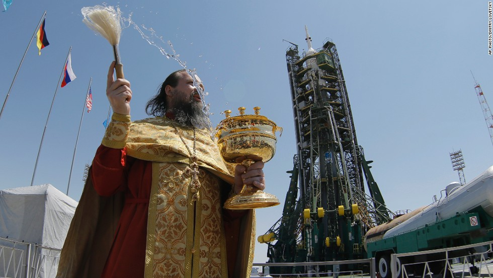 MAY 28 - KAZAKHSTAN: An Orthodox priest conducts a blessing service in front of the Soyuz TMA-13M spacecraft at the Russian leased Baikonur Cosmodrome on May 27. The Soyuz is scheduled to launch on May 29.