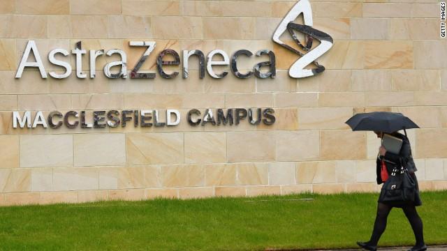 A woman walks outside British pharmaceutical company AstraZeneca in Macclesfield, northwest England.