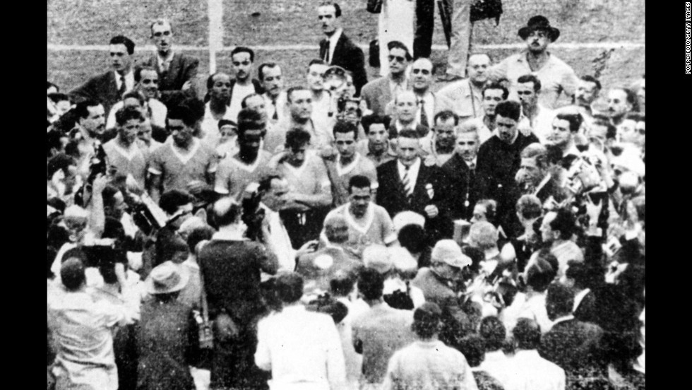 FIFA President Jules Rimet presents the trophy to Varela, Uruguay's captain. Uruguay also won the first World Cup, which it hosted in 1930, and it remains by far the smallest country to have won the tournament.