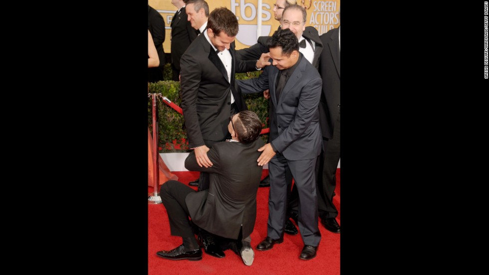 Sediuk hugs Bradley Cooper's legs as Michael Pena looks on at the 2014 Screen Actors Guild Awards in Los Angeles on January 18.