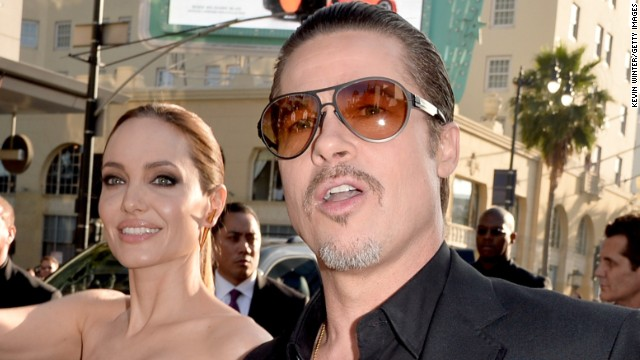 Caption:HOLLYWOOD, CA - MAY 28: Actors Angelina Jolie (L) and Brad Pitt attend the World Premiere of Disney's 'Maleficent' at the El Capitan Theatre on May 28, 2014 in Hollywood, California. (Photo by Kevin Winter/Getty Images)