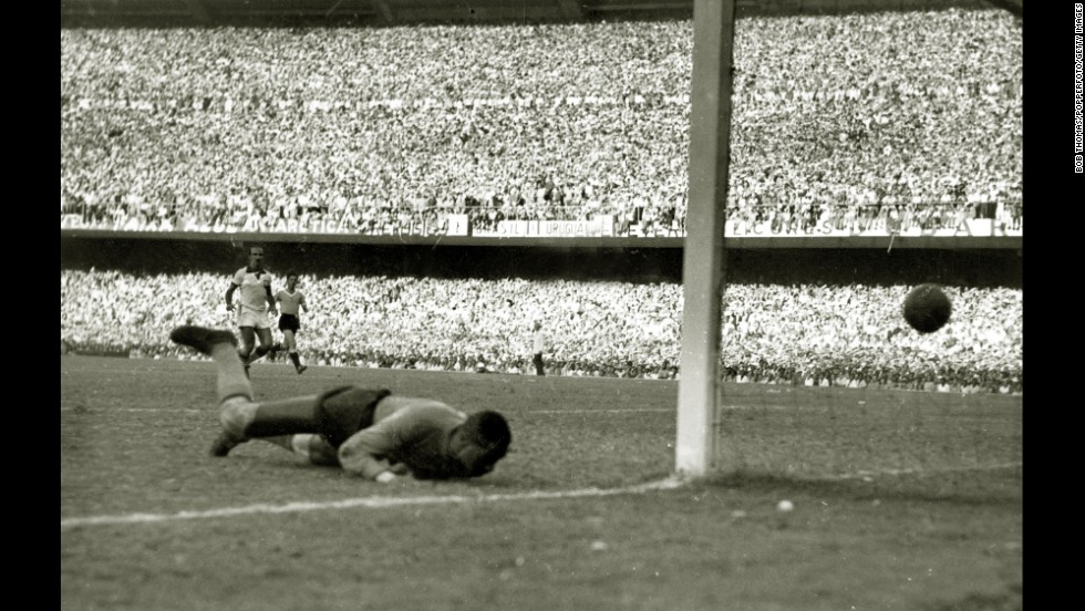 "Brazilian goalkeeper Barbosa is beaten at the near post by Ghiggia's game-winning goal. The error that led to the goal <a href=""http://www.cnn.com/2013/06/14/sport/football/brazil-confederations-cup-neymar-pele-football/"">hung over Barbosa</a> until his death in 2000. Some 20 years after the final, he saw a woman in a supermarket point toward him and say to the young boy by her side: ""Look at him, son. He is the man that made all of Brazil cry."""