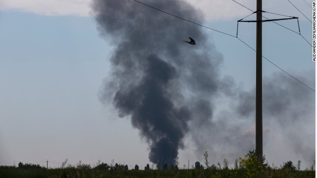 Smoke rises from a shot-down Ukrainian army helicopter outside Slovyansk, Ukraine, on Thursday.