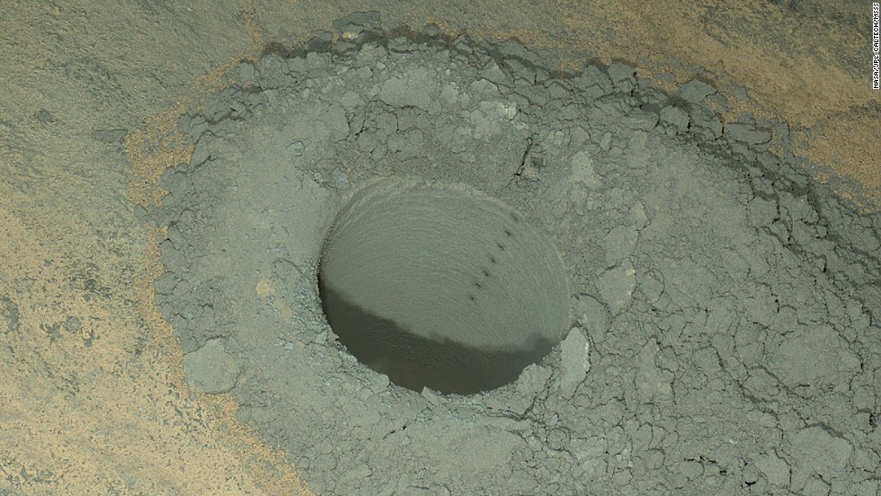 Curiosity took this nighttime photo of a hole it drilled May 5 to collect soil samples. NASA said this image combines eight exposures taken after dark on May 13.