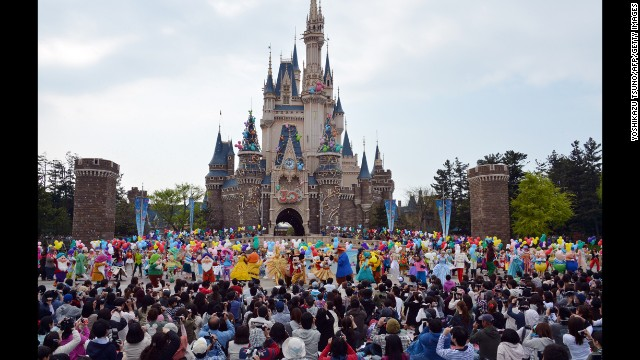 Disney characters and dancers celebrate the 30th anniversary of the Tokyo Disneyland during a ceremony at the Disney theme park in Urayasu, suburban Tokyo on April 15, 2013. Tokyo Disney resort, Tokyo Disneyland and Tokyo DisneySea, drew a combined 567 million visitors in their 30 years.   AFP PHOTO / Yoshikazu TSUNO        (Photo credit should read YOSHIKAZU TSUNO/AFP/Getty Images)