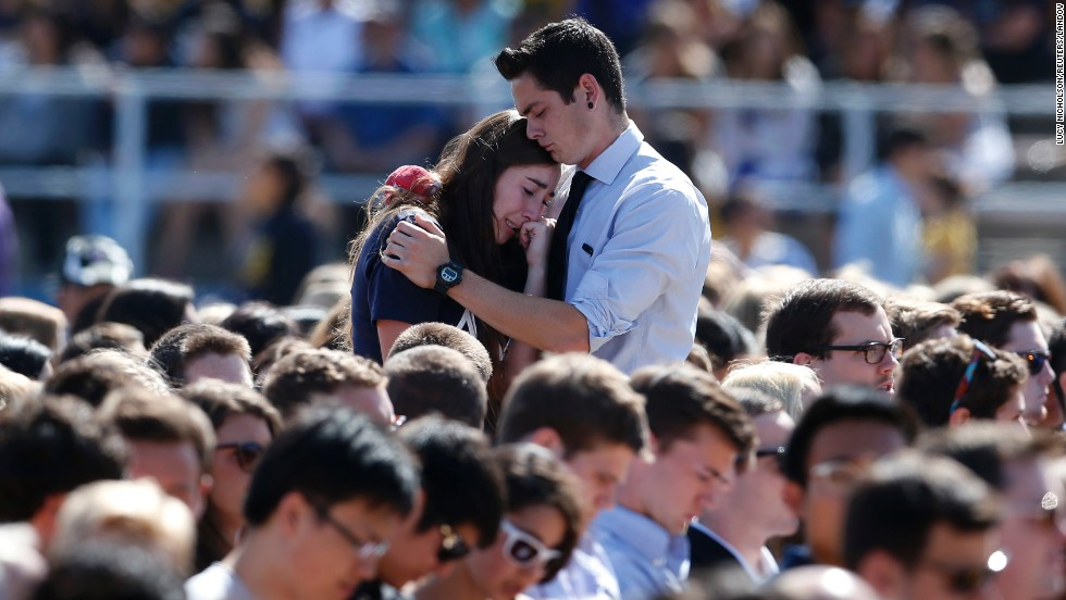 "Students console each other at a memorial service held Tuesday, May 27, for victims of <a href=""http://www.cnn.com/2014/05/24/us/gallery/isla-vista-shooting/index.html"">a shooting rampage</a> near the University of California, Santa Barbara. Elliot Rodger, 22, stabbed three people to death at his apartment before shooting and killing three more in a nearby neighborhood, sheriff's officials said. Rodger also injured 13 others and died of an apparent self-inflicted gunshot wound, authorities said."
