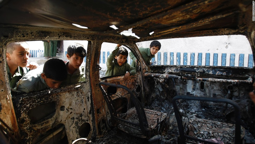 On Tuesday, May 27, boys in the Arhab region of Yemen look inside a vehicle that was destroyed during a police raid on an al-Qaeda hideout. Yemen said on May 25 that it had killed one of the country's most-wanted al-Qaeda militants.