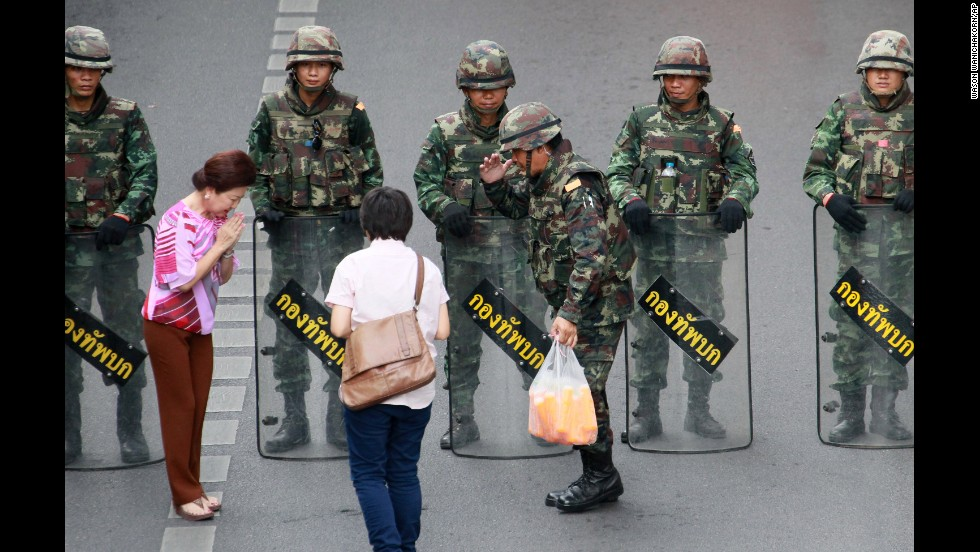 "Well-wishers hand cold drinks to Thai soldiers who are trying to prevent a demonstration in Bangkok, Thailand, on Thursday, May 29. Thailand's military recently <a href=""http://www.cnn.com/2014/05/19/asia/gallery/thailand-crisis/index.html"">took control of the country</a> in a coup."