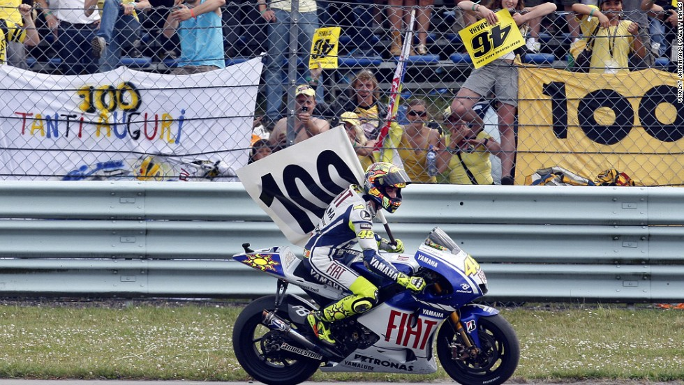 Rossi's fanatical fans celebrate his 100th grand prix win at the Dutch MotoGP at Assen in the Netherlands in 2009.