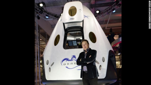 SpaceX CEO Elon Musk introduces SpaceX's Dragon V2 spacecraft, the companys next generation version of the Dragon ship designed to carry astronauts into space, at a press conference in Hawthorne, California, May 29, 2014. The private spaceflight companys unmanned Dragon spacecraft has been delivering cargo to the International Space Station three times since 2012. The new Dragon V2 will ferry NASA astronauts to and from the space station. AFP PHOTO / Robyn Beck (ROBYN BECK/AFP/Getty Images)