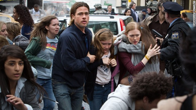 2013 Paramount Pictures. All Rights Reserved. Titles: World War Z Names: Brad Pitt, Fabrizio Zacharee Guido Characters: Gerry Lane, Karin Lane, Tomas Still of Brad Pitt and Fabrizio Zacharee Guido in World War Z (2013)