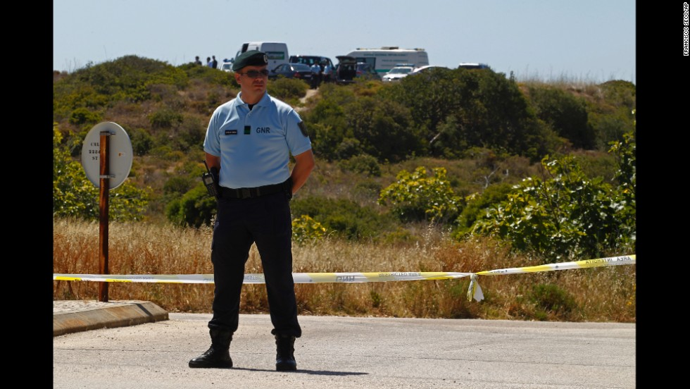A Portuguese Republican Guard policeman stands guard as police begin digging in an area of wasteland near Praia da Luz on June 2, 2014.