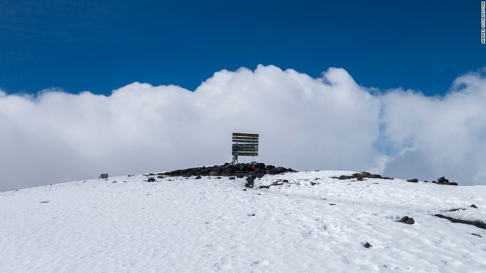 Alone on Uhuru Peak. Three corks from bottles of champagne were the only sign that somebody had been there earlier.