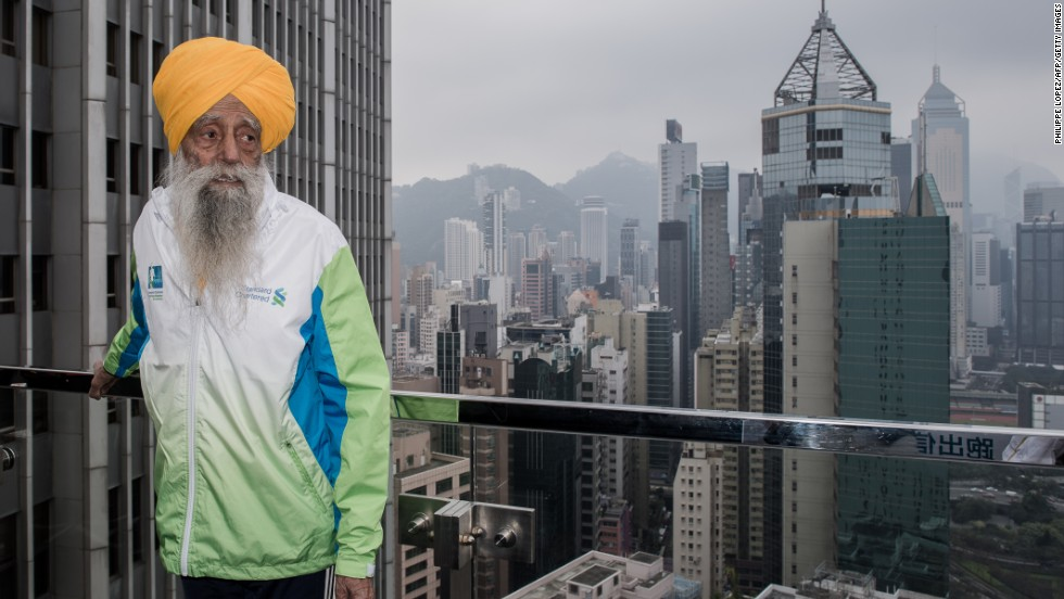 "<a href=""http://www.cnn.com/2013/05/09/sport/fauja-singh-marathon-oldest/index.html"">Fauja Singh is recognized</a> as the first 100-year-old to ever run a marathon. The great-grandfather, now 103, continues to run or walk every day. Nicknamed the ""Turbaned Tornado,"" he took up running to overcome his grief after the death of his wife and a son. He ran his first marathon at age 89. The key to life: ""Laughter and happiness,"" he says. ""That's your remedy for everything."""