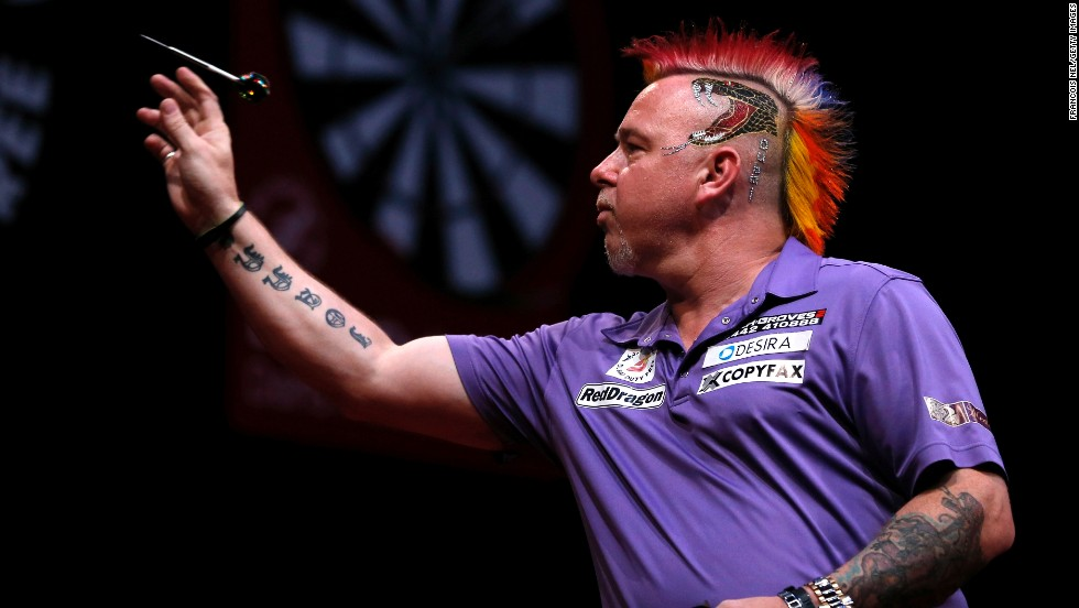 "Peter Wright, a professional darts player from England known for his <a href=""http://www.dailymail.co.uk/sport/othersports/article-2531863/PETER-WRIGHT-interview-Wife-Jo-does-hair-takes-two-hours-day.html"" target=""_blank"">always-changing hair color</a>, competes Friday, May 30, in the semifinals of the Dubai Duty Free Darts Masters. The event, held in Dubai, United Arab Emirates, was the first World Series of Darts event this year. Wright advanced to the final but lost to Michael van Gerwen."