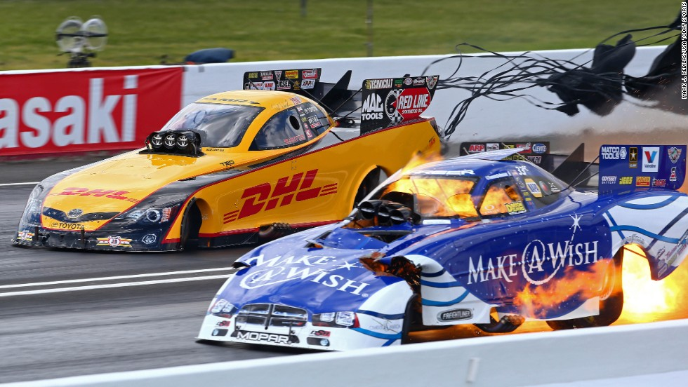 Fire is seen under the funny car of National Hot Rod Association driver Tommy Johnson Jr. during qualifying for the Summernationals event Saturday, May 31, at New Jersey's Raceway Park. It is not uncommon to see fire under funny cars and other drag racing vehicles as their engines are pushed to the limit.