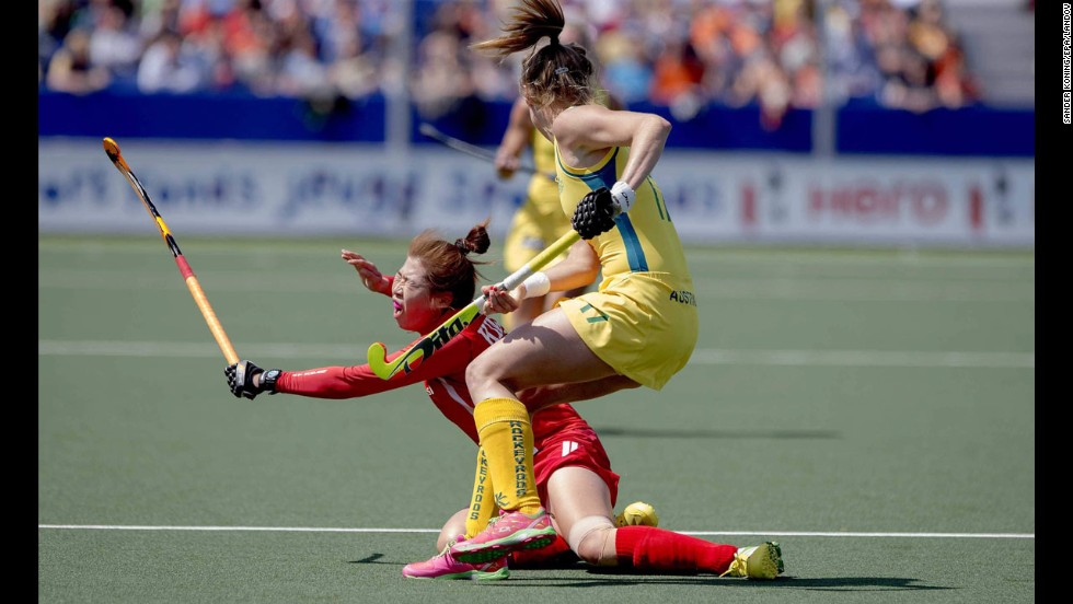 Australia's Emily Hurtz, right, and South Korea's Youngran Kim tussle for the ball during a match Saturday, May 31, at the Women's Hockey World Cup in The Hague, Netherlands. Australia won 3-2 in what was the opening match for both teams.