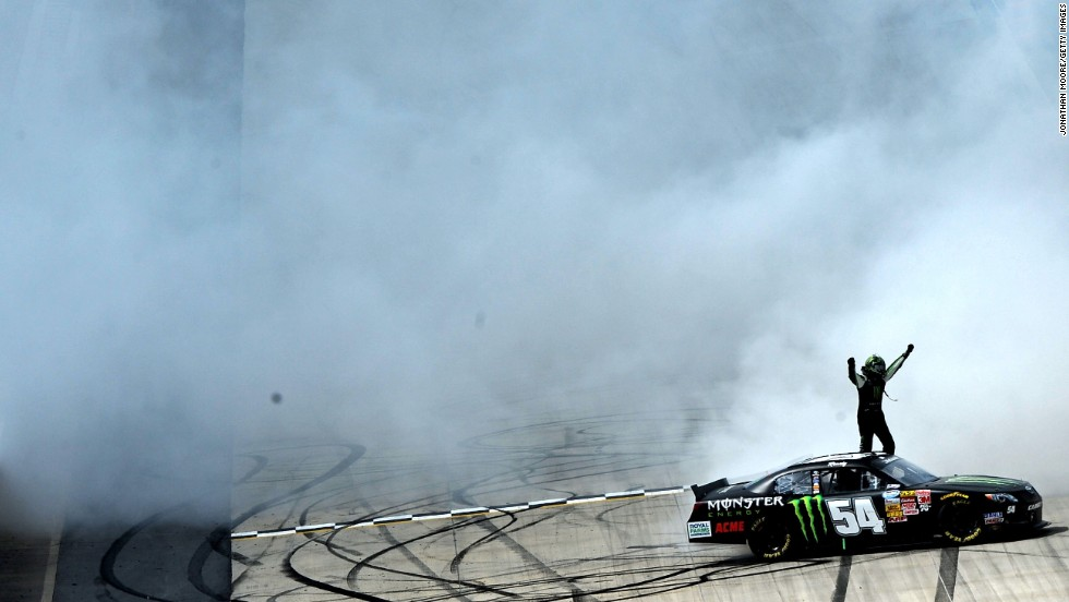 NASCAR driver Kyle Busch celebrates with a burnout after winning the Nationwide Series event Saturday, May 31, at Dover International Speedway in Dover, Delaware. It was Busch's third win this year in the Nationwide Series, which is NASCAR's second-tier circuit. Busch also has a win this year in the top-tier Sprint Cup Series.