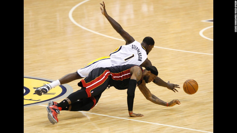 Indiana's Lance Stephenson and Miami's LeBron James dive for a loose ball Wednesday, May 28, during Game 5 of the NBA's Eastern Conference finals. Indiana won the game but lost the series to Miami, which is looking to win its third straight NBA title.