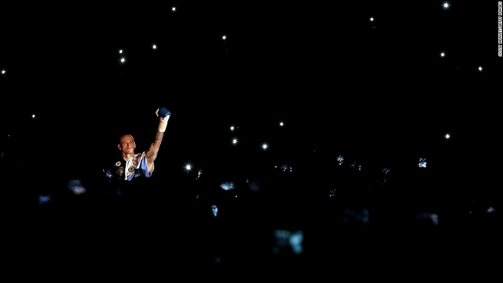 Boxer George Groves enters the ring for his middleweight title fight with Carl Froch at London's Wembley Stadium on Saturday, May 31. Froch won with a devastating eighth-round knockout.
