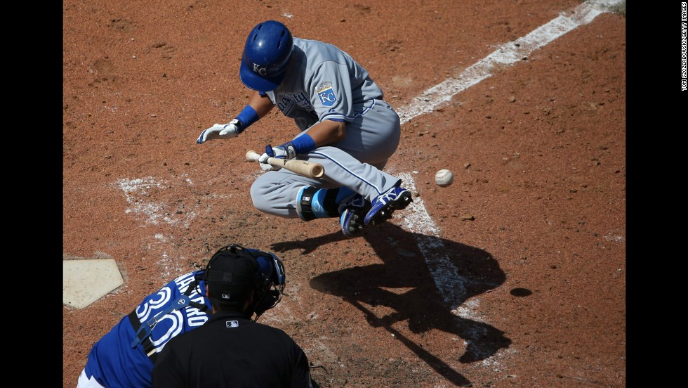 With the bases loaded, Kansas City's Norichika Aoki, right, is hit by a pitch in a game against the Toronto Blue Jays on Saturday, May 31. The Royals won the game 6-1 but split a four-game series with the Blue Jays in Toronto.