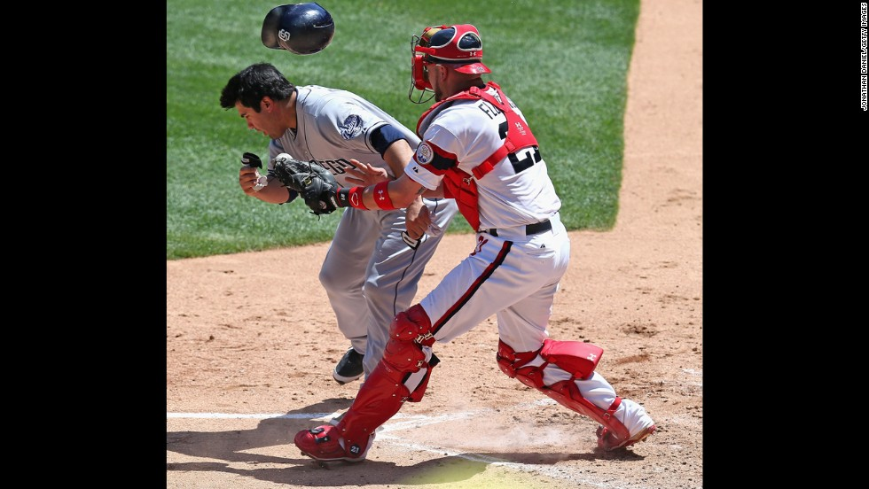 Catcher Tyler Flowers of the Chicago White Sox tags Carlos Quentin of the San Diego Padres during a collision at home plate Saturday, May 31, in Chicago. The Padres won 4-2 and took two of three in the series.