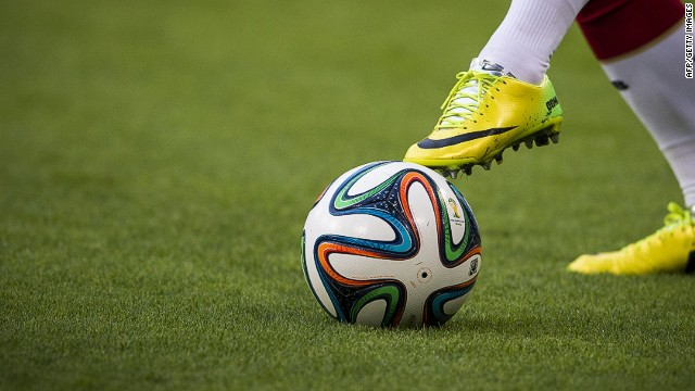A German player warms up with the Brazuca, the official football of the 2014 World Cup, prior to a friendly football match between Germany and Poland at the Imtech arena in Hamburg on May 13, 2014. AFP PHOTO / ODD ANDERSENODD ANDERSEN/AFP/Getty Images